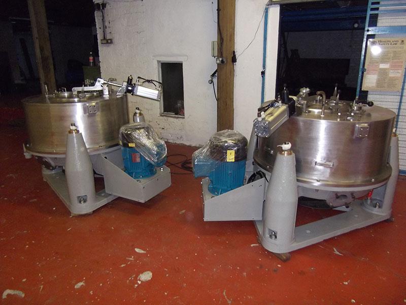 Refurbished Centrifuges on Floor of Workshop